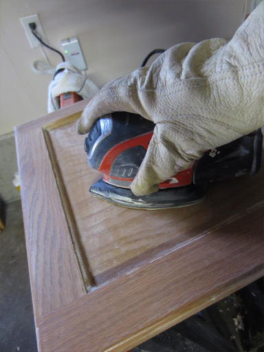 sanding cabinet faces in preparation for painting