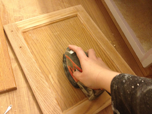 Repainting A Bathroom Vanity Using A Corner Sander