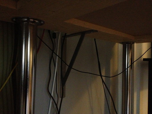 fixing a wobbly standing desk with shelf brackets
