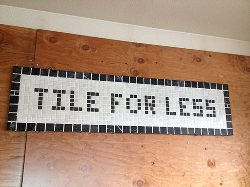 Tile for Less sign mosaic tiled