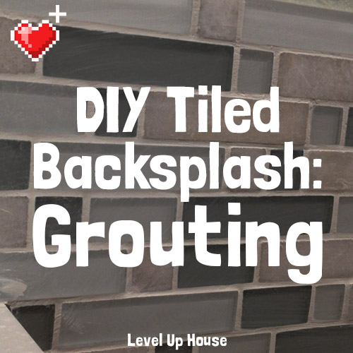 DIY Tiled Kitchen Backsplash: Part 5. How to grout your DIY kitchen backsplash. It's like spreading frosting over little glass tiles!