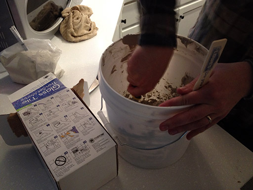 DIY kitchen backsplash: follow the instructions on the box to mix your mortar.