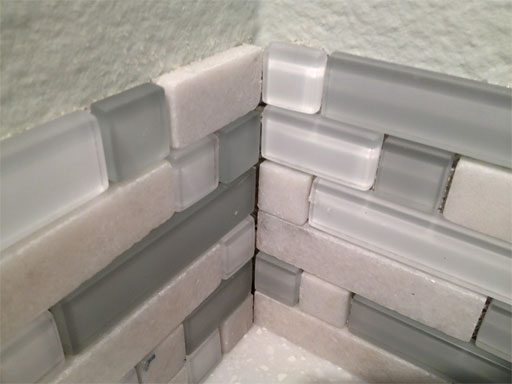 Diy kitchen backsplash part 4 installing backsplash tiles for Tiling a backsplash inside corner
