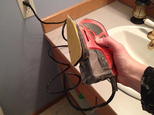 stain_bathroom_vanity_corner_sander