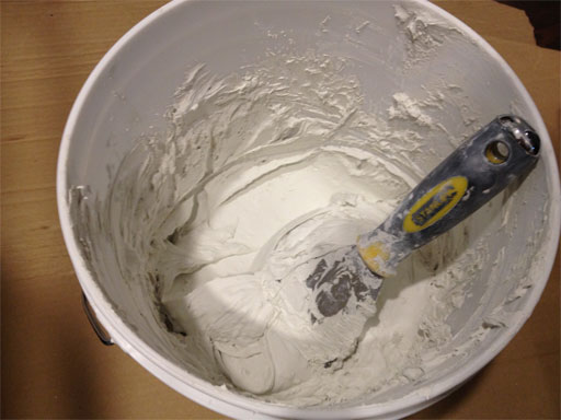 DIY Kitchen Backsplash: Mixing grout. If you can make brownies from a mix, you can make your own grout.