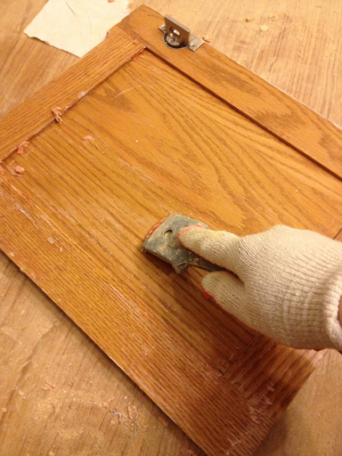refinishing a wood vanity scraping off old varnish