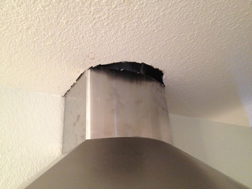 patching ceiling drywall next to range hood exhaust duct
