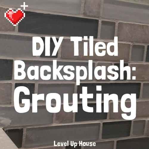 DIY Tiled Kitchen Backsplash: Part 5. How to grout your DIY kitchen backsplash. It's like spreading frosting over little glass tiles!