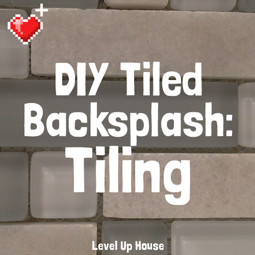 """DIY kitchen backsplash: In part 4 of our """"how to install your own tiled backsplash"""" series, we glue tiles to the wall using a bucket of mortar. Installing your own backsplash is easy - follow along!"""