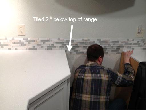 DIY kitchen backsplash: tiling behind the range in anticipation of a future range upgrade.