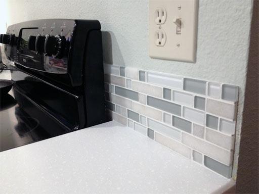 """DIY kitchen backsplash: Our 6"""" backsplash, freshly grouted and looking sharp."""